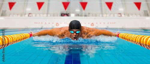 Man in swimming pool. Butterfly style Canvas Print