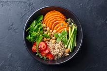 Healthy Vegetarian Salad. Roasted Pumpkin, Quinoa, Tomatoes, Green Salad. Buddha Bowl. Slate Background. Top View.