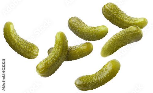 Falling delicious marinated pickled cucumbers, isolated on white background Canvas-taulu