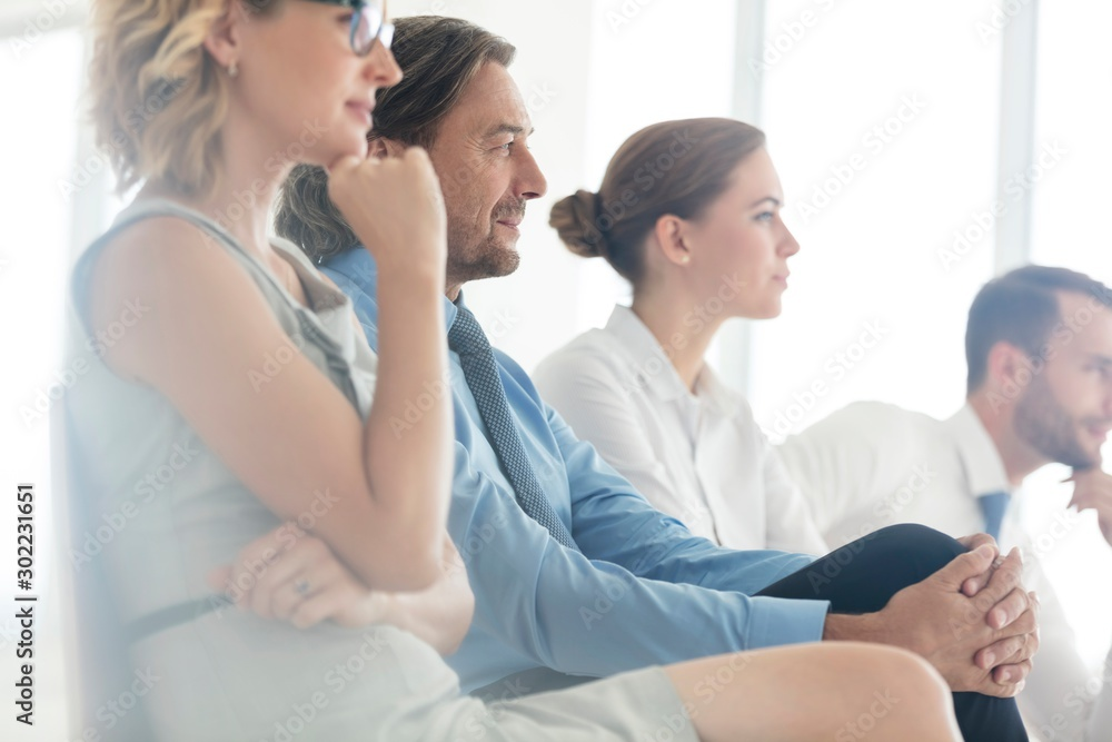 Fototapety, obrazy: Business people sitting while listening on meeting in office