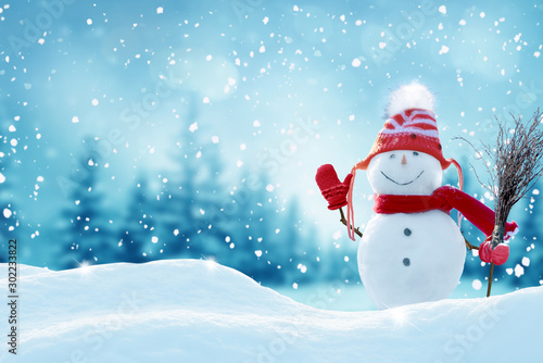Poster Pool Happy snowman standing in christmas landscape.Snow background.Winter fairytale.Merry christmas and happy new year greeting card with copy-space.