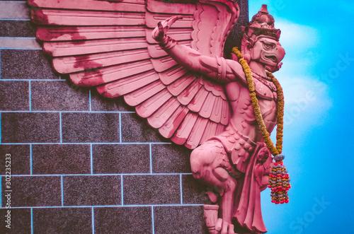 Foto auf Leinwand Kastanienbraun BANGKOK, THAILAND -2018 : Garuda statue at wall of Bangkok Bank building .Aerial view landscape and cityscape of Bangkok city from General Post Office or Grand Postal Building at Bang Rak District .