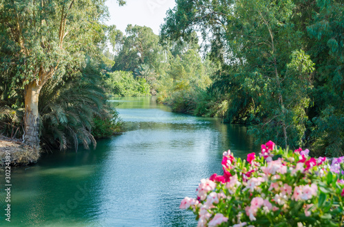 Fototapeta Jordan river in Yardenit Baptismal Site (Kvutzat Kinneret, Galilee, Israel)