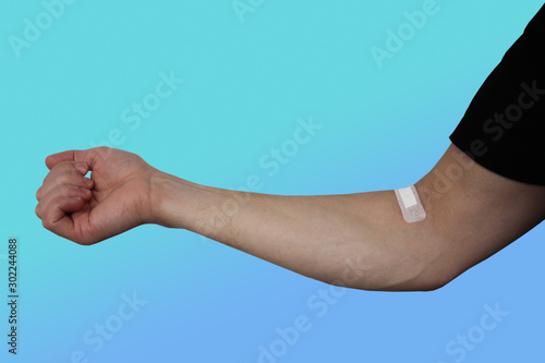 male hand sealed on the inside of the elbow with a medical plaster, concept intr Wallpaper Mural