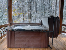 Outdoor Hot Tub On A Cabin Deck In The Winter