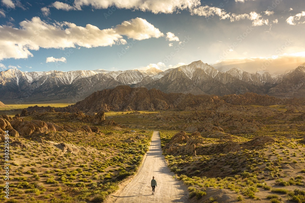 Fototapety, obrazy: Lonely person walking on a pathway in Alabama hills in California with Mount Whitney in background