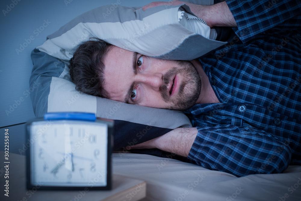 Fototapeta Man feeling bad because of insomnia disorder