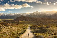 Lonely Person Walking On A Pathway In Alabama Hills In California With Mount Whitney In Background