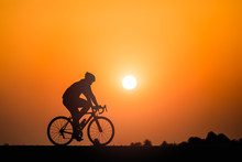 Silhouette Man Cycling On Suns...