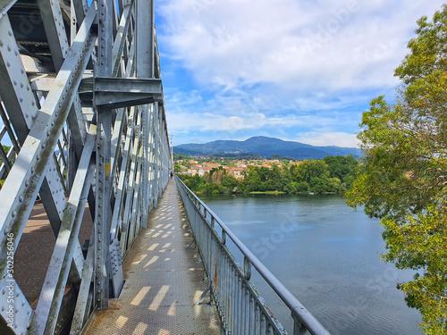 Valokuvatapetti Metal bridge over Minho river