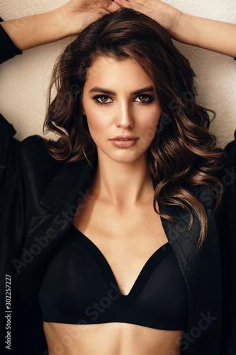 Fotografie, Obraz beautiful sexy woman in elegant clothes posing in studio