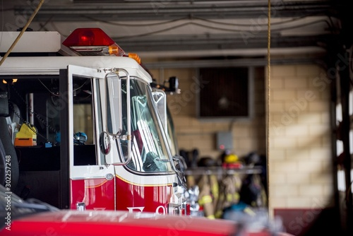 Closeup shot of a firetruck with an open door and a blurred background Tableau sur Toile
