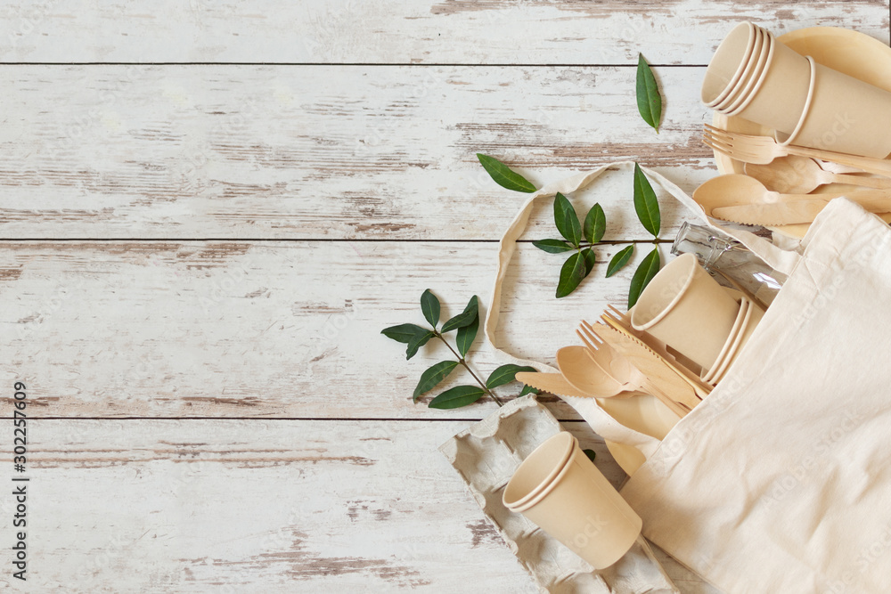 Fototapety, obrazy: Eco friendly disposable dishes made of bamboo wood and paper on white wooden background.