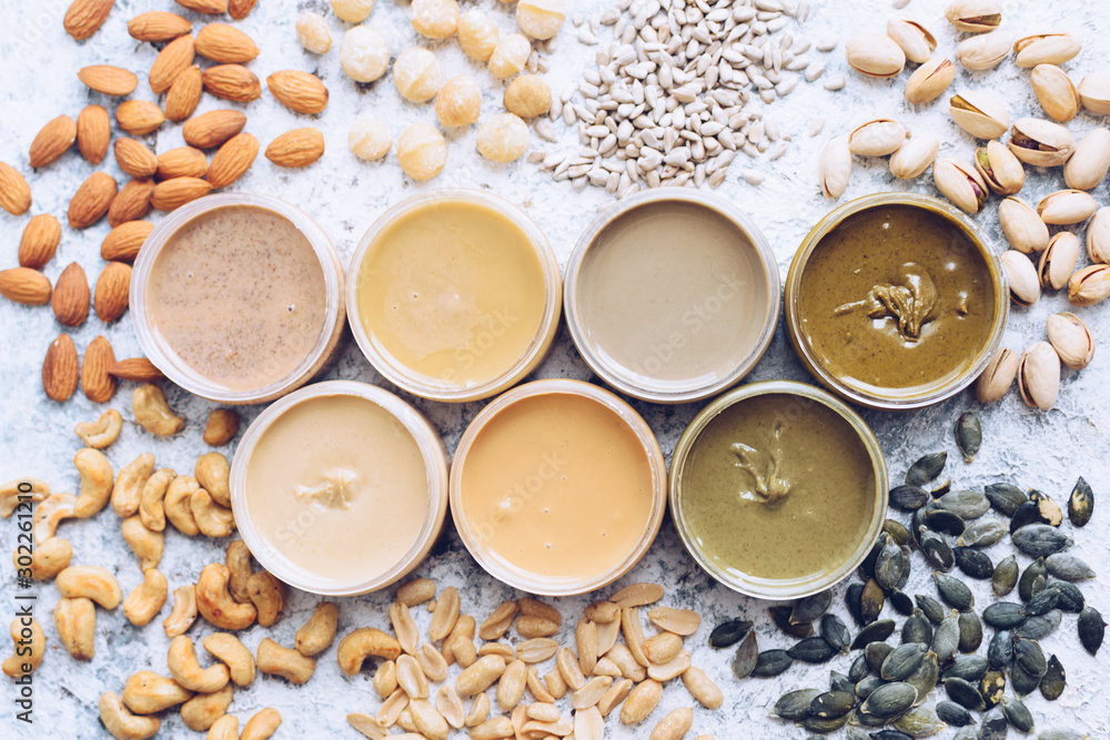 Fototapety, obrazy: Nuts and seeds butter in glass jars