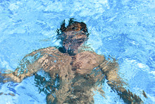 Silhouette Of A Man Under Water
