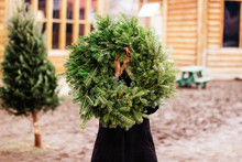 Young Woman Carrying A Christm...