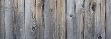 Panoramic Picture Of A Natural Grey Wooden Texture With Knots And Nail Heads. Uncolored Rustic Background
