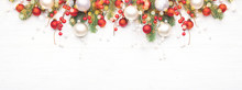 Classic Christmas Composition With Fir Branches And White And Red Baubles On White Wooden Background. Noel Banner For Website.