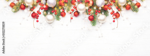 Poster Countryside Classic Christmas composition with fir branches and white and red baubles on white wooden background. Noel banner for website.