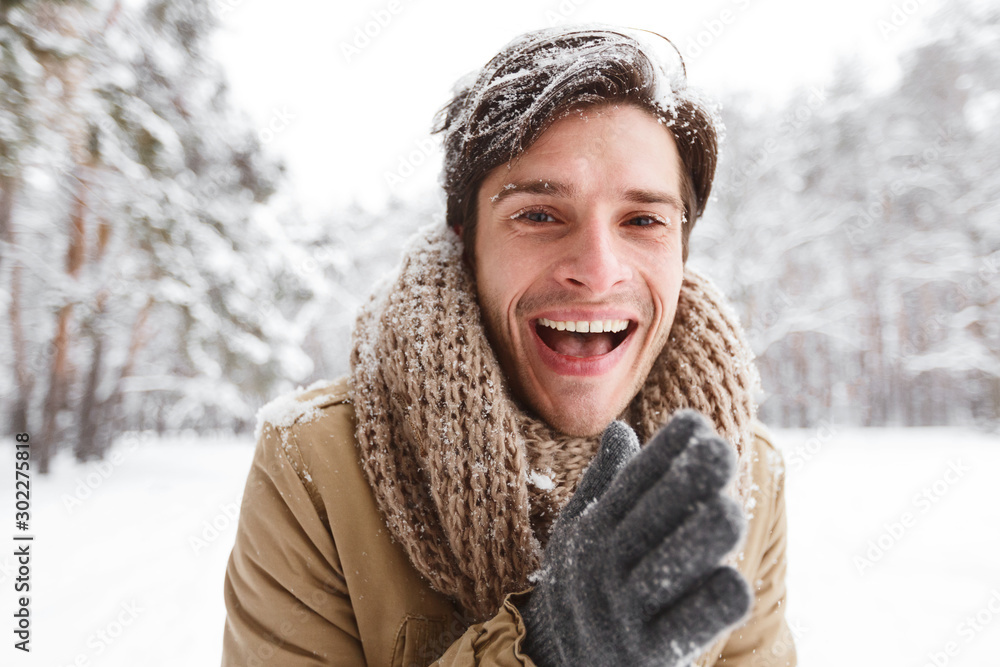 Fototapety, obrazy: Guy Rubbing Hands To Warm Up Standing In Winter Forest