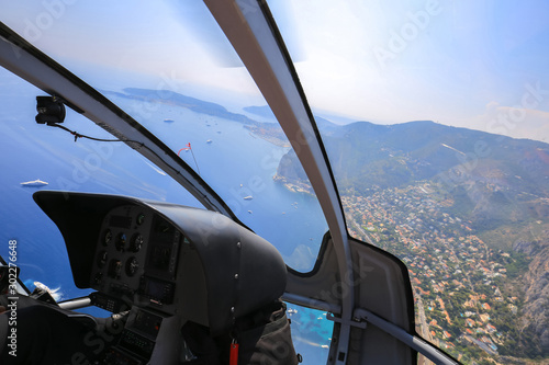 Foto op Canvas Helicopter Helicopter ride over the sea