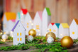canvas print picture - Closeup of paper house of Christmas advent calendar on wooden background