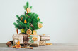 canvas print picture - Dried citrus slices on the Christmas tree with craft paper wrapping gift boxes