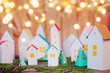 canvas print picture - Christmas advent calendar of paper houses with garland lights