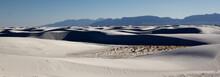 Sand Dunes Cast Shadows On The...