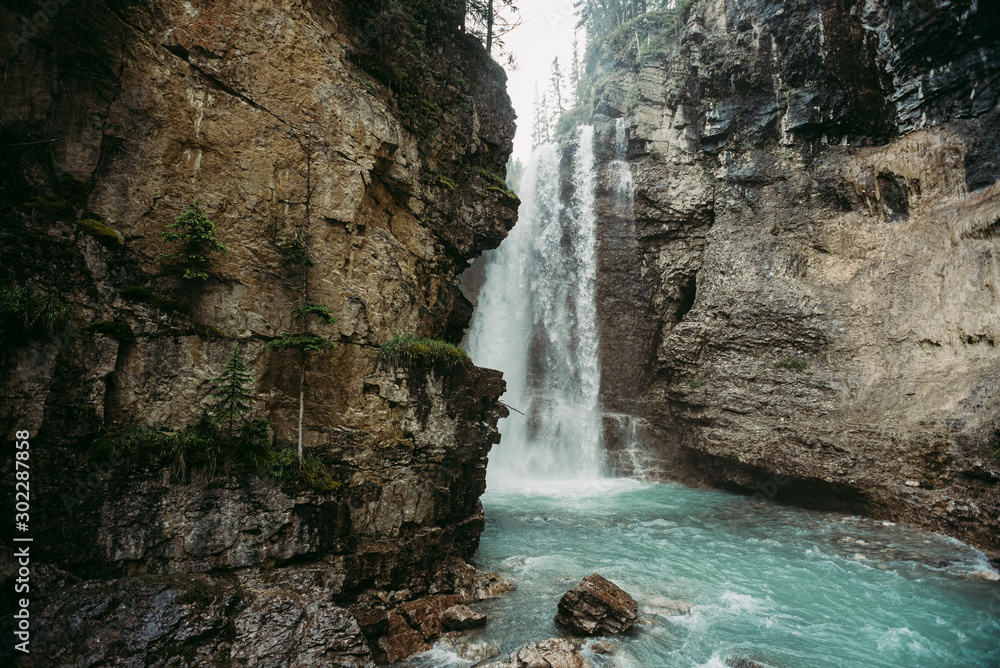 Upper waterfall of Johnston Canyon hiking trail in Alberta, Canada.