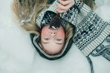 Girl Lying In The Snow And Enj...