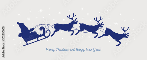 Obraz Cute Christmas picture with silhouette of Santa Claus in a sleigh pulled by deer. Happy winter holidays. Xmas layout creative card. Design element for New Year banners, posters, flyers. - fototapety do salonu