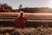 Little Girl Outdoors In Autumn...