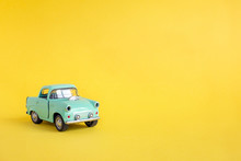 Toy Car On The Road On A Yellow Bacground .