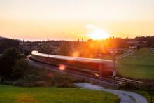 Germany, Upper Bavaria, Regional Train At Sunset