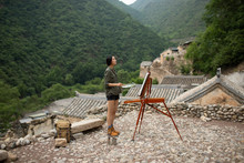 Young Chinese Woman Painting Outdoors
