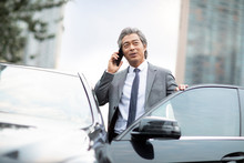 Confident Chinese Businessman ...