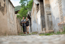 Young Chinese Couple Walking I...