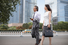 Successful Chinese Business People Walking On Street
