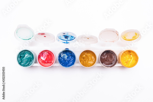 Cuadros en Lienzo Gouache colorful paint in a jar isolated on white background.