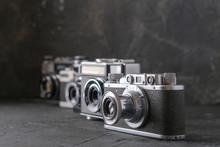 Old Antique Film Cameras Against A Dark Background.