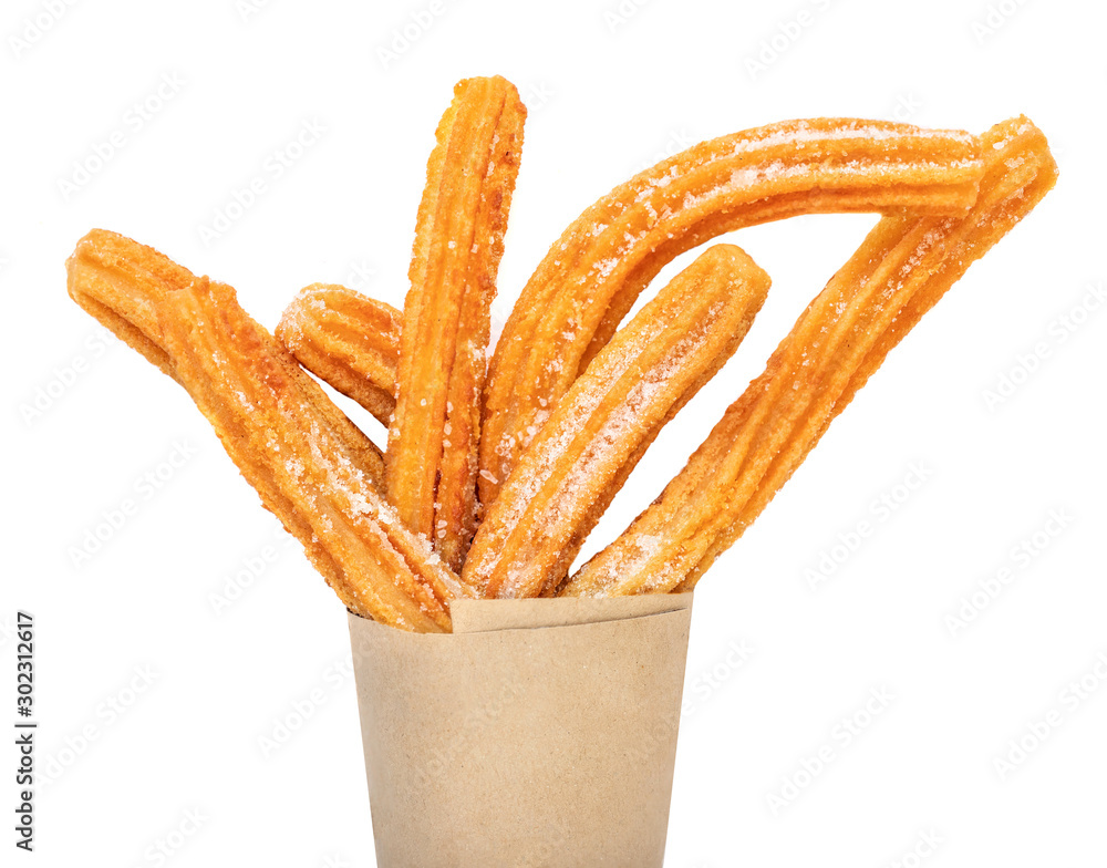 Fototapety, obrazy: Churro stick in apaper bag.  Churro - Fried dough pastry with sugar powder isolated on a white background.  Close up