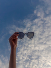 Woman Hand With Sunglasses On ...
