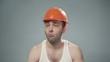 Video of drunk man wearing orange helmet