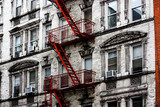 a typical New York building with a red fire escape in the Soho district - 302317432