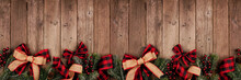Christmas Border Banner With Red And Black Checked Buffalo Plaid Ribbon, Burlap And Tree Branches. Above View On A Rustic Wood Background.