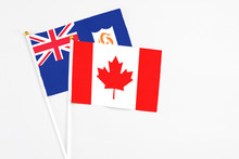 Canada And Anguilla Stick Flags On White Background. High Quality Fabric, Miniature National Flag. Peaceful Global Concept.White Floor For Copy Space.