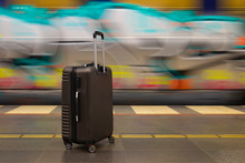 Baggage On Wheels At Railway Station Near Moving Train With Graffity. Waiting During Traveling Or Holiday With Luggage