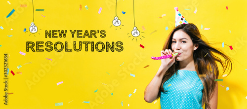 Cuadros en Lienzo  New Year's Resolutions with young woman with party theme on a yellow background