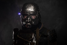 Close Up Photo Shoot Of Man In Helmet With Gas Mask And Small Flash Light On Side.